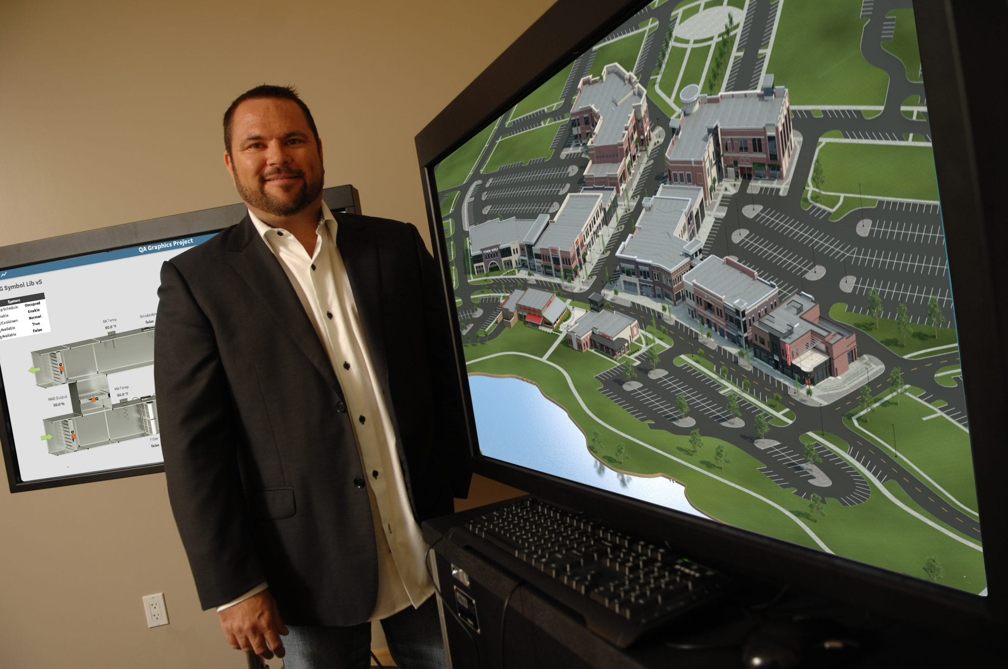 Owner, Dan McCarty showing the 3D exterior renderings for Prairie Trail District.