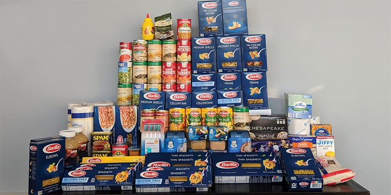 Yearly employee food bank drive - About QA Graphics